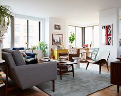 Attractive-apartment-living-room-ideas-together-with-wooden-table-and-chairs-also-with-gray-sofa-and-rugs-plus-table-lamp-and-british-flag-photo-as-well-as-ceramic-floor | The Exciting And Outstanding Living Room Ideas | Digsdecor.com