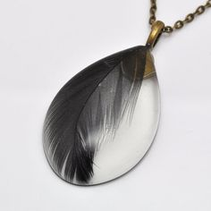 Black feather in teardrop resin necklace  pendant on by PikLus, $15.00