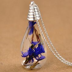 Such an original pendant necklace with a flower inside a little light bulb! Click for more details.