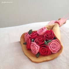 Make easy beautiful clay roses with this tutorial.