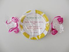 The party invitations were wrapped with cellophane and tied on the ends to look like candy.