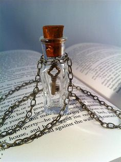 One of my Favorite Necklaces to wear. Steampunk skeleton key in glass vial necklace by FiendishWear, $18.50
