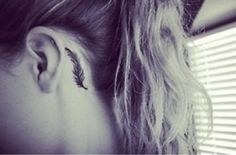 feather tattoo hand | Cute black and white feather tattoo on back ear - Tattoo Mania