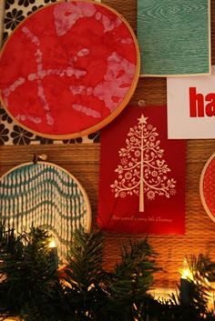 Paint canvas red then paint a white Christmas tree with simple ornaments