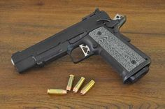 The ultimate fighting handgun. Double stack (14 rounds) of 10mm in an all steel 1911 with a rail for attachments like lights and lasers.