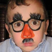 Groucho glasses face painting.
