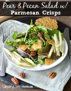 This recipe for Pear & Pecan Salad w/ Parmesan Crisps is easy to put together with make ahead components - great for a fancy meal. #StellaTakesManhattan #ad