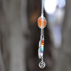 A personal favorite from my Etsy shop https://www.etsy.com/listing/233115014/7-chakras-om-native-feather-crystal-cage
