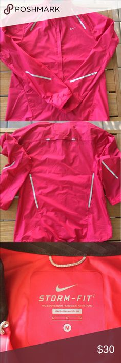 Nike Storm Fit jacket Light weight. Raspberry color. 100% polyester. Very little wear. Nike Jackets & Coats Utility Jackets