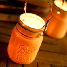 Lanterns are hand-cast porcelain, made from molds of antique jars. Hand-wrapped wire handles are perfect for hanging. A simple votive candle is all the flame you need to make them glow!