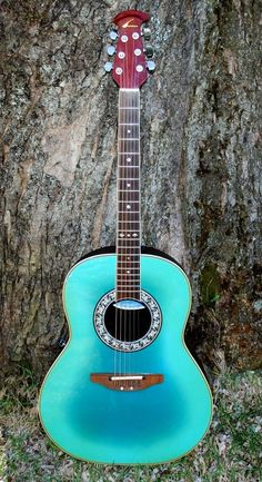 Aqua Acoustic Guitar...we are in love!!