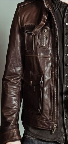 Brown leather with multiple pocket and zippers.  Jackets are another place to show off your personal style.