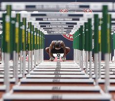 David Oliver prepares to start in the men's 110 meter hurdles qualifying round at the U.S. Olympic Track and Field Trials in Eugene, Ore.