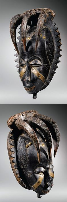Africa | Mask from the Yaure (Yohourè) people of the Ivory Coast | Wood with dark patina, decorated with brass plates and tacks | ca. 1919 - 1935: