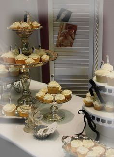 Love the cupcake stands made from old silver trays and mercury glass candle sticks