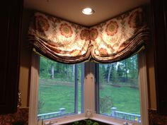 Relaxed Roman shade in Kitchen corner window