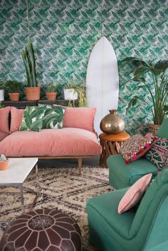 We love the soft, retro colors and wallpaper print in this living room