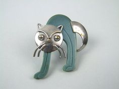 Cat Brooch by Bengel Modernist chrome and blue galalith cat brooch. Made in the early 1930's by Bengel.