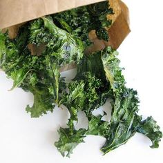 Toss two large handfuls of chopped and washed kale in a bowl with extra virgin olive oil, salt, and pepper. Line a baking sheet with tin foil and bake at 300 degrees for 20 minutes...Kale is my new favorite veggie, it's so good, very hearty, tastes great and so many ways to prepare it or eat it raw!!!