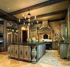 This is so elegant. I love the colors. When I think of gourmet kitchen. this is my go to image.  It feels like a place you would want to turn out some amazing meals for your family...spending hours a day in here would NOT be a hardship. I would never be comfy in one of those industrial, all steel , cold kinda kitchens..but I could live in this one.
