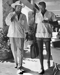 John Wayne and Gary Cooper - Ok, I pinned this for two reasons. 1. The men of Hollywood just looked so much more like MEN back then!  2.  Check out Gary Cooper's outfit closely, down to the shoes.  They're the best part!  :D  (And he's still manlier than a lot of stars today!)