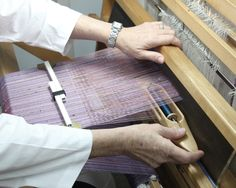 Artist Barb Butler prepares her loom individually for every new piece.