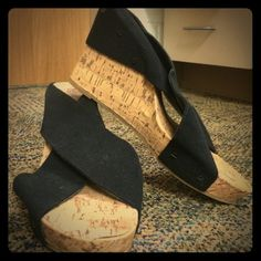 Black cross strap wedges Black cross strap wedges. They are elastic so your foot is comfortable in the shoe. This shoe can fit a 9-10. Cute for daytime wear or to dress up an outfit. Shoes Wedges