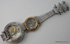 April 26/16 - Four new Watch Parts Guitars made from a collection of old family watches sent to me by the client.