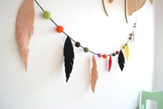 DIY fabric feather garland for tribal-themed nursery