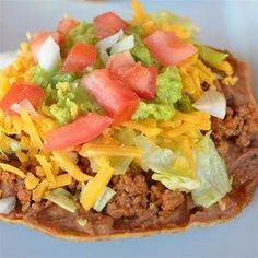 "Crispy Oven Beef-and-Bean Tostadas | ""A healthier way to make tostadas and better tasting. The simple secret to making crispy tostadas is baking the corn tortillas instead of frying."""