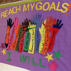 A school SLP encourages her students to reach for their goals.