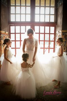 Matching flower girl dresses with the bride's wedding dress is such a cute idea. Check out those flip flops with bling! | Lynda Berry Photography