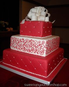 Red and white present wedding cake