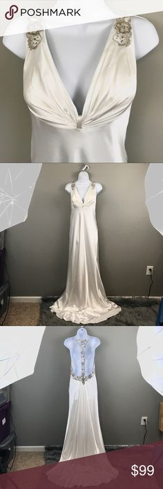 NWT La Femme White Bridal / Prom Gown New with tags, never worn. 100% polyester, feels like satin. Gorgeous back detail. Train on back. Bust 15.25 length front- 61.5 back- 71 La Femme Dresses