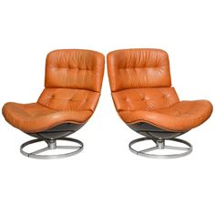 Pair of Unusual Milo Baughman Swivel Chairs | From a unique collection of antique and modern swivel chairs at http://www.1stdibs.com/furniture/seating/swivel-chairs/