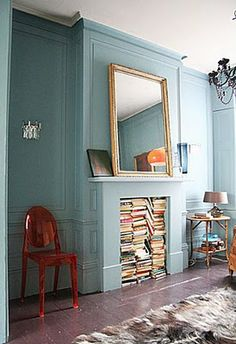Books. What a great idea! If I ever have a fireplace that I don't use, I'll do this, but add shelving and place them vertically instead so I can read my titles!