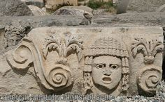 Mysterious face sculptures of Myra: Ancient theater masks carved on hundreds of stone blocks on pebbles at Myra. (Today in Antalya, Turkey)