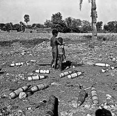 Two peasant children stand amidst unexploded bombs in a village in former East Pakistan during the 1971 Pakistan-India war. History Of Pakistan, East Pakistan, Conversation Starter Questions, First Prime Minister, Military Coup, Catholic School, Political Events, Time Magazine, Countries Of The World