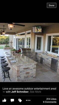 Outdoor kitchen/bar with ceiling fans.