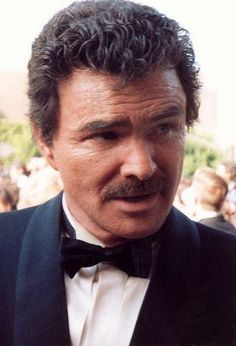 "Burton Milo ""Burt"" Reynolds, Jr. (born February 11, 1936) is an American stand-up comedian, actor, director, and comedian. Some of his memorable roles include Bo 'Bandit' Darville in Smokey and the Bandit. Over the years Reynolds was romantically involved with Tammy Wynette, Lucie Arnaz, Adrienne Barbeau, Susan Clark, Sally Field, Lorna Luft, Tawny Little, Pam Seals, Dinah Shore and Chris Evert. He was married to actress Judy Carne from 1963 to 1965, and Loni Anderson from 1988 to 1993."