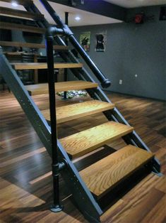 Metal Stairs that save time, child maintenance and eliminate custom fabrication. In stock, ready to ship. metal stairs, steps, metal do its stuff platforms and portable stairs. Pipe Railing, Stair Railing Design, Railings, Steel Stairs Design, Stair Treads, Basement Steps, Open Basement, Basement Ceilings, Basement Bars