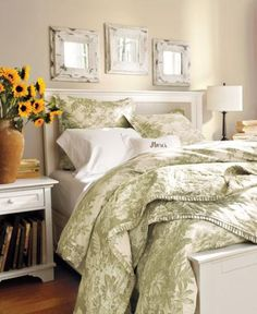 A blank canvas of white wood furniture provides a versatile backdrop for whatever bedding suits your mood. Here, floral bedding in soft sage sets a calm tone. Over the bed, three pressed-tin mirrors help amplify natural light and recall the charm of Victorian architecture.  Benjamin Moore™ Paint Color:  950 natural wicker