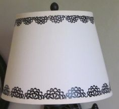 From my very talented mom!  Way to go MJ!  Plain white lampshade decorated with Cricut vinyl.  Knockoff of one I saw at Pottery Barn
