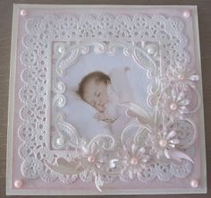 A large doily with the center cut out for the photo then embellished. Absolutely Lovely. Could also be used for a wedding photo.