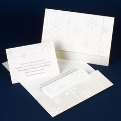 This white and pearlescent invitation with an eye-catching snowflake design holds coordinating enclosures in a pre-cut slot. Open the tri-fold invitation to reveal your wording inside.