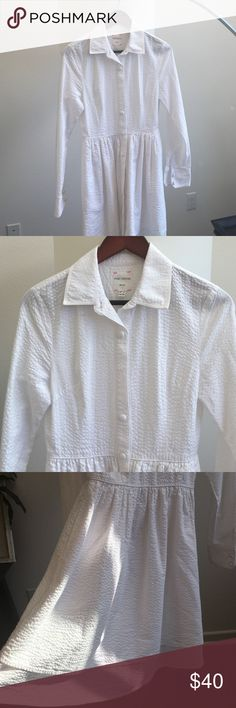 Pink Tartan white seersucker shirt dress This Pink Tartan white seersucker is the only Gilt purchase I have ever made. All photos have no filter so you can see this is a true white. Size 6. Like new condition but missing one fabric button. This is a midi dress with the front hitting the knee and back a bit longer. Not see through as it's a thick cotton and has two regular size hand pockets. I am a hypoallergenic, pet free, smoke free and perfume free girl. pink tartan Dresses High Low