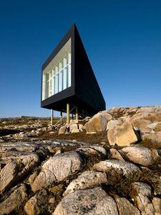 artists' residences studio built on fogo island. stark, dramatically positioned on rugged landscape of the nova scotia islands.