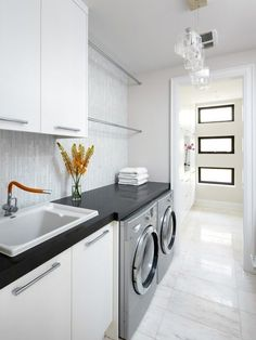 Laundry Room Idea contemporary laundry room features ivory shaker cabinets paired