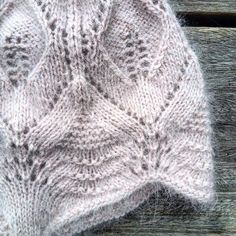 Lace hat with earflaps. The hat is knitted from the bottom up. The earflap piece is knitted flat and the rest of the hat is knitted in the round by…