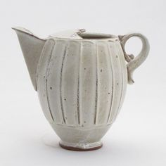 White pitcher by American ceramic artist Pete Scherzer. via the clay studio
